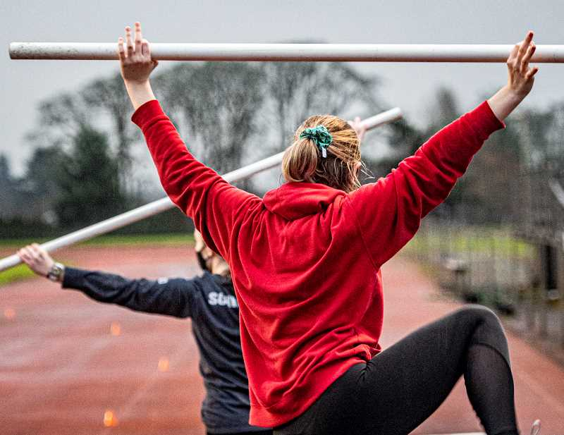 COURTESY PHOTO: JOSI WELTER - Student athletes practice at the Scappoose High School field before the track and field season.