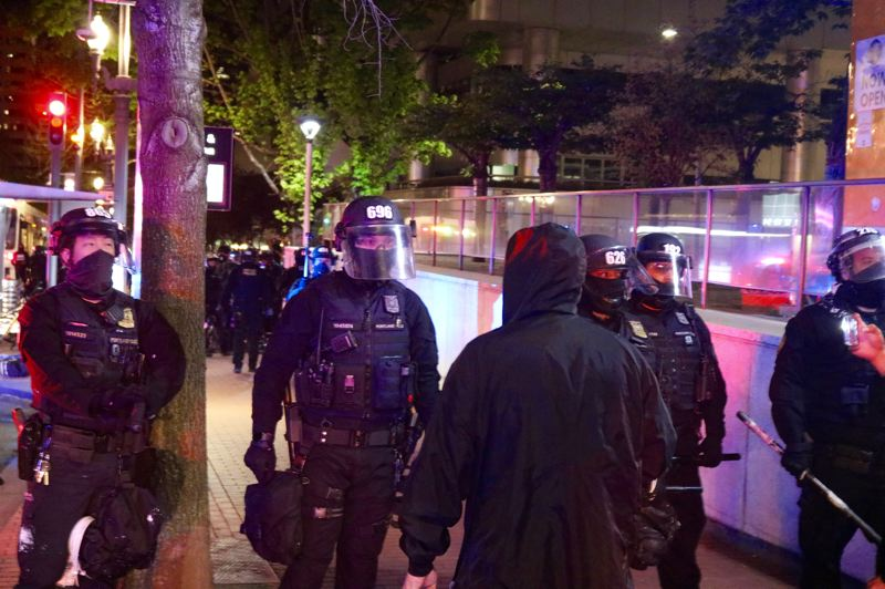 PMG PHOTO: ZANE SPARLING - Portland police and protesters squared off near a TriMet bus stop in downtown Portland during a protest on Tuesday, April 20.