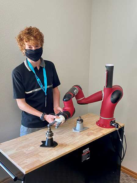 COURTESY PHOTO: ANDREW LATTANNER, PCC - A student works at OMIC R&D during the 2020 Columbia Works internship cycle.