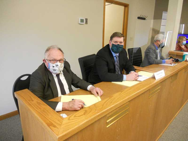 PMG PHOTO: SCOTT KEITH - St. Helens city councilor Stephen Topaz (front of the photo) is sitting alongside his attorney at an open hearing April 20.