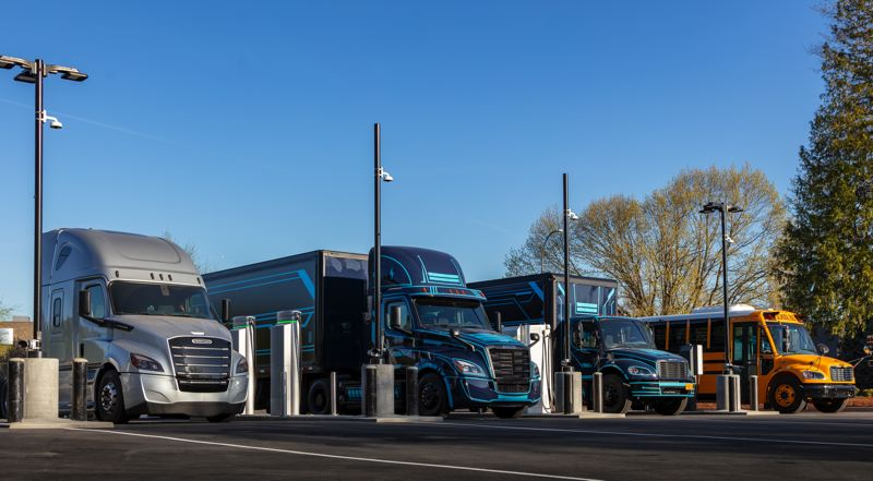 COURTESY PHOTO: DAIMLER TRUCKS NORTH AMERICA  - Heavy duty electric vehicles at the new Electric Island charging station on Swan Island. The include eCascadia and eM2 trucks made by Daimler.