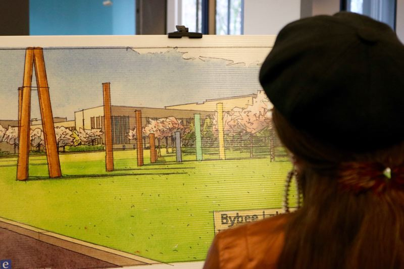 PMG PHOTO: ZANE SPARLING - A woman inspects a rendering for the proposed Bybee Lakes Hope Center during a fundraiser in January 2020. By converting the never-used Wapato Jail in Portland into a homeless shelter and resource center, regional leaders hope to get hundreds off the streets.
