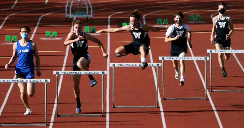 PMG PHOTO: MILES VANCE - In the 300-meter intermediate hurdles, Wilsonville's Cooper Hiday ran to victory against La Salle at Wilsonville High School on Wednesday, April 21. The rest of the top four included Wilsonville's Liam Dunn and Jackson Pippert, and La Salle's Seth Wobig.