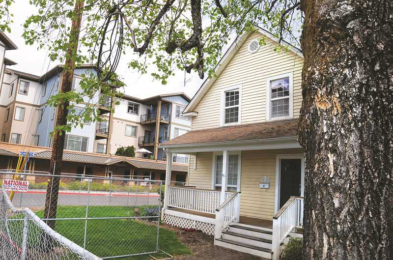 PMG PHOTO: GARY ALLEN - Nine homes slated to be razed to make way for expansion of Friendsview Manor will be stripped of all usable materials by crews from the local Habitat for Humanity affiliate.