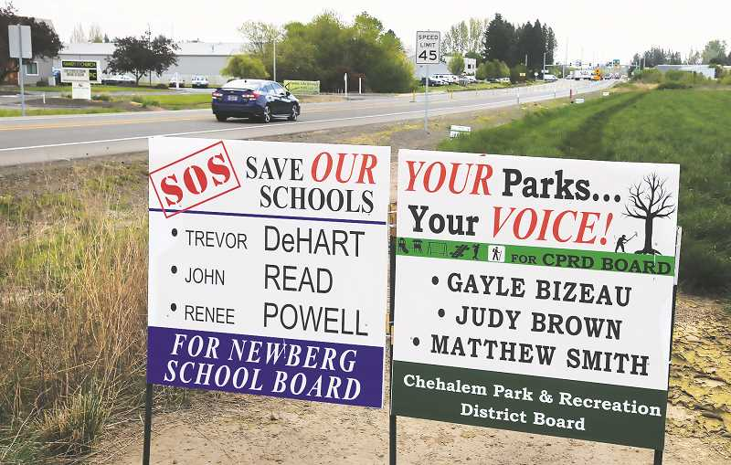 PMG PHOTO: GARY ALLEN - Political signs endorsing a number of individuals for spots on the school and park boards have begun sprouting up around Newberg in anticipation of the May election.