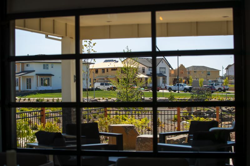 PAMPLIN MEDIA GROUP: JAIME VALDEZ - The view across the greenway from the model home, which serves as the Newland office at Reed's Crossing. The New Urbanism is to encourage neighbors to interact, not hide in their cars and back rooms.