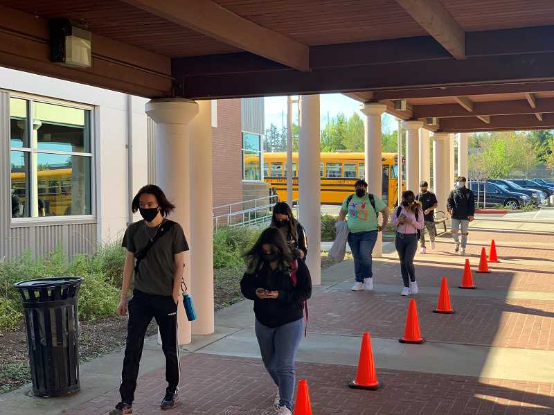 COURTESY PHOTO: TIGARD-TUALATIN SCHOOL DISTRICT - Students enter Tualatin High School for the first time in a year this week.