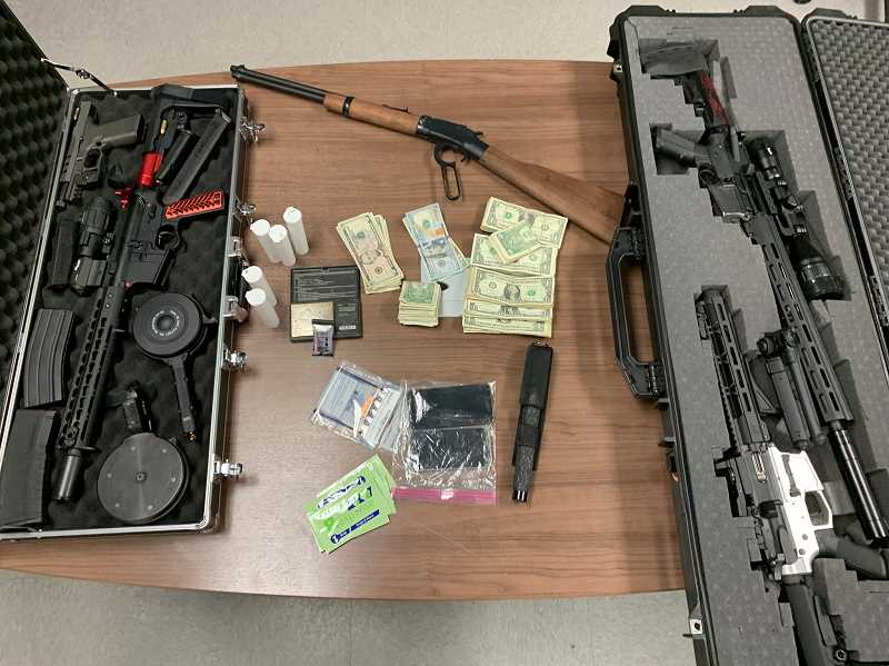 COURTESY PHOTO: COLUMBIA COUNTY SHERIFF'S OFFICE - Investigators searched a house in Rainier and found cash, firearms, records of drug transaction, fentanyl test strips and 17.2 grams of heroin.