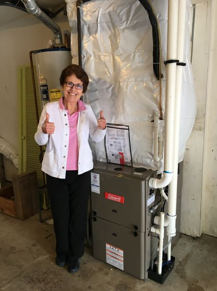 COURTESY PHOTO - Lynn Yale with her new furnace.