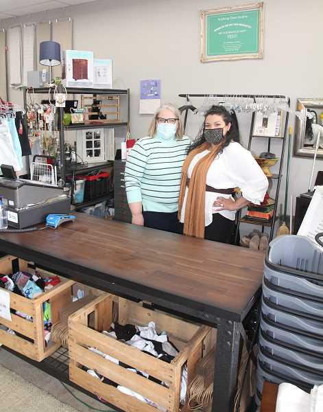 PMG PHOTO: JUSTIN MUCH - Anything Goes owner Tammy Flora, left, and manager Alexis Ontiveros have always enjoyed searching for bargains. Now at the relatively new store in Woodburn, they enjoy sharing bargains with customers.