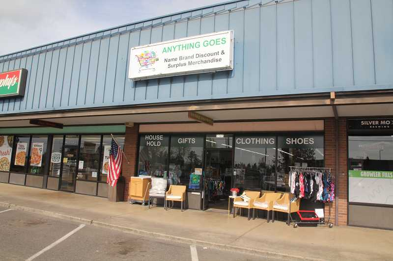 PMG PHOTO: JUSTIN MUCH - Anything Goes surplus store is located between Papa Murphy's Pizza and the Woodburn Liquor Store, at the site that formerly housed Wallace Video.