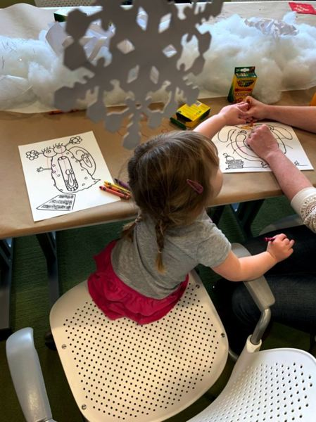 COURTESY PHOTO - A child works on coloring while listening to International Children's Arts Network.