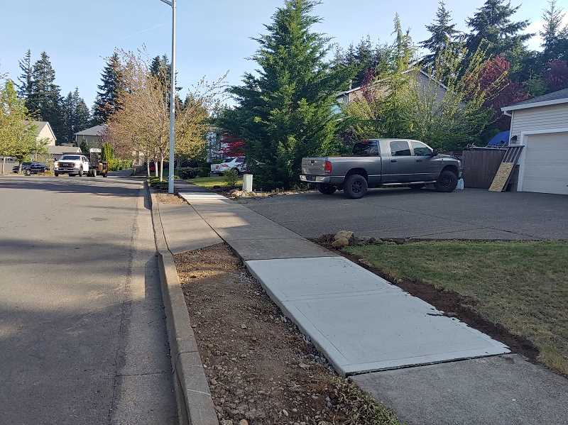 PMG PHOTO: RAYMOND RENDLEMAN - Many residents of the Trailview neighborhood in Oregon City have already removed trees and replaced sidewalk panels after getting incorrect threatening letters from the city.