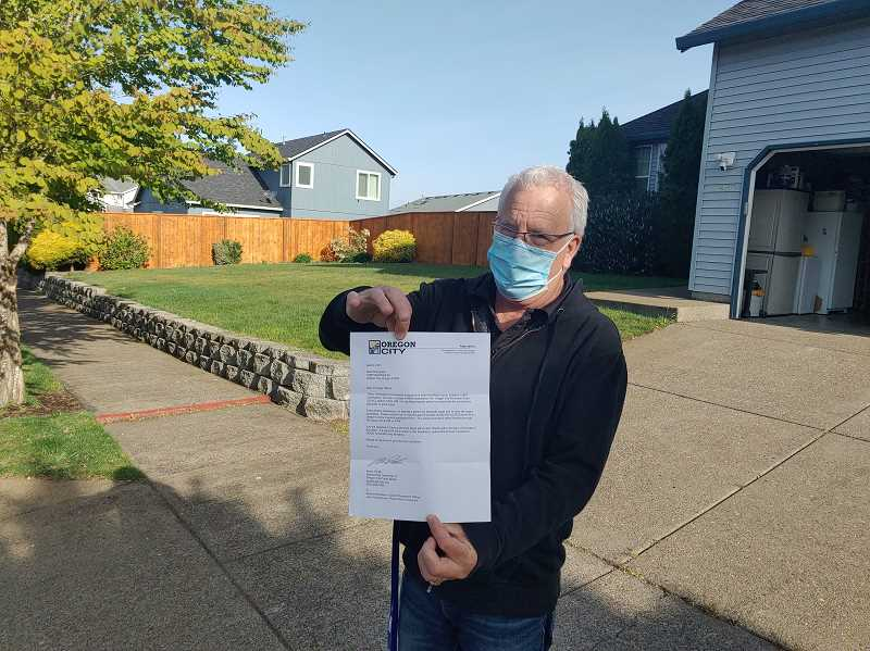 PMG PHOTO: RAYMOND RENDLEMAN - Scott Thompson, whose house is on Smithfield Drive, was among the many Oregon City homeowners who received incorrect letters from city officials.