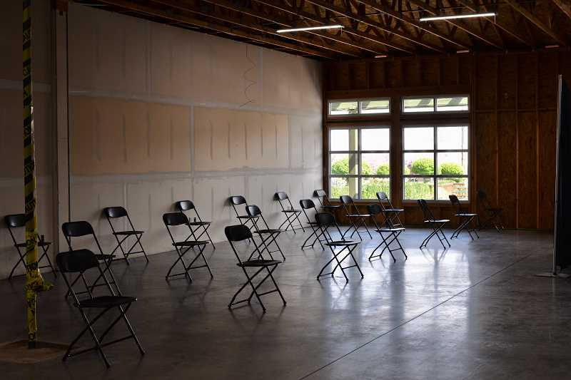 PMG PHOTO: ANNA DEL SAVIO - Chairs are placed in a vaccination site in Scappoose for patients to remain for a monitoring period after receiving their shot.
