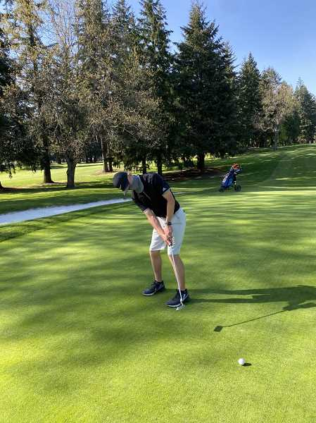 COURTESY PHOTO - Tigard's Max Niemi hits a putt during a recent practice. Niemi is one of three juniors leading the Tigers this season.