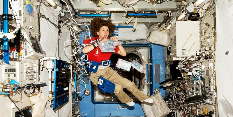 COURTESY PHOTO - Cady Coleman works on Expedition 26 aboard the International Space Station in 2011.