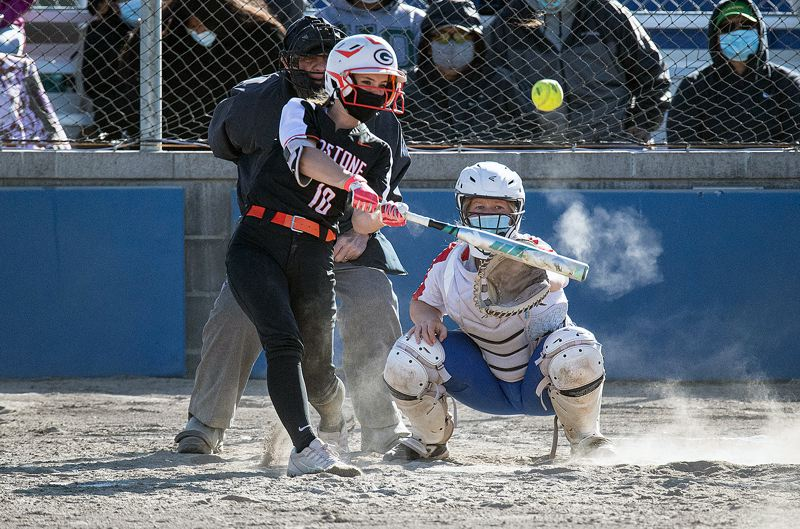 PMG PHOTO: LON AUSTIN - Gladstone's Delaney McNett connects for one of her two home runs during the Gladiators' 14-13 win over Madras at Madras High School on Thursday, April 22.