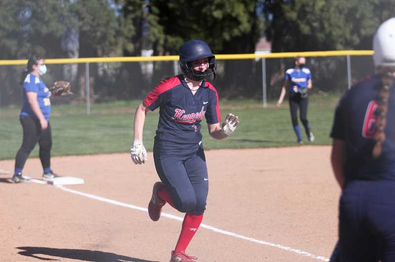 PMG PHOTO: PHIL HAWKINS - Kennedy's Ellie Cantu crosses home plate in the Trojans win over Gervais the previous week. The Trojans have played just 16 innings in four games, winning each contest by mercy rule while outscoring opponents 67-0 to open the season.