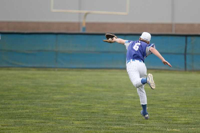 PMG PHOTO: PHIL HAWKINS - St. Paul junior Brody Schindler stretches out for a leaping back handed catch in the Buckaroos' 14-2 loss to the Kennedy Trojans on Friday.