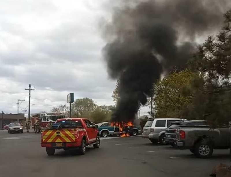PHOTO COURTESY OF JENNIE PORT - A pickup truck caught fire Sunday, April 25 and spread to two nearby cars in the Black Bear Diner parking lot.