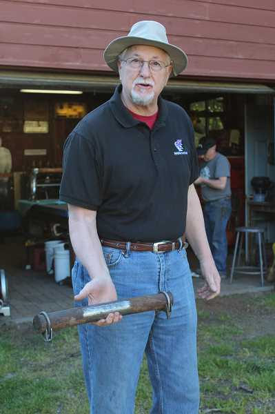 PMG PHOTO: COURTNEY VAUGHN - Ted Coonfield shows a piece of cable from the original Portland Aerial Tram. Coonfield recently commissioned local metalsmith Dan Johnson to use pieces of the discarded cable in a table he helped make.