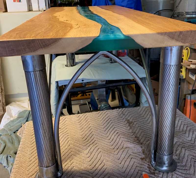 COURTESY PHOTO: RICK NITTI - A river table hand-crafted by Ted Coonfield and Dan Johnson was recently gifted to Rick Nitti. Nitti formerly served as executive director of Neighborhood House in Portlands Multnomah neighborhood.