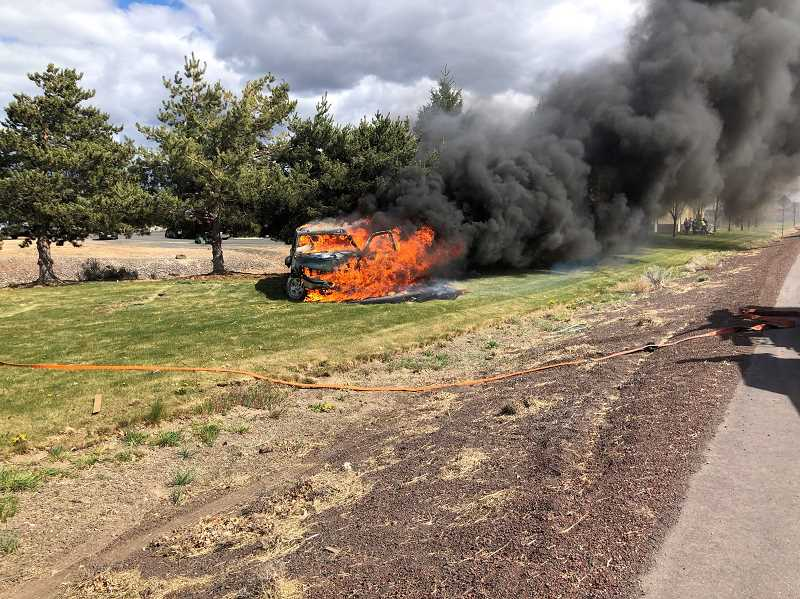 JEFFERSON COUNTY FIRE DISTRICT NO. 1 PHOTO - Highway 26 was closed temporarily Monday afternoon at Cherry Lane after a vehicle crashed and burned.