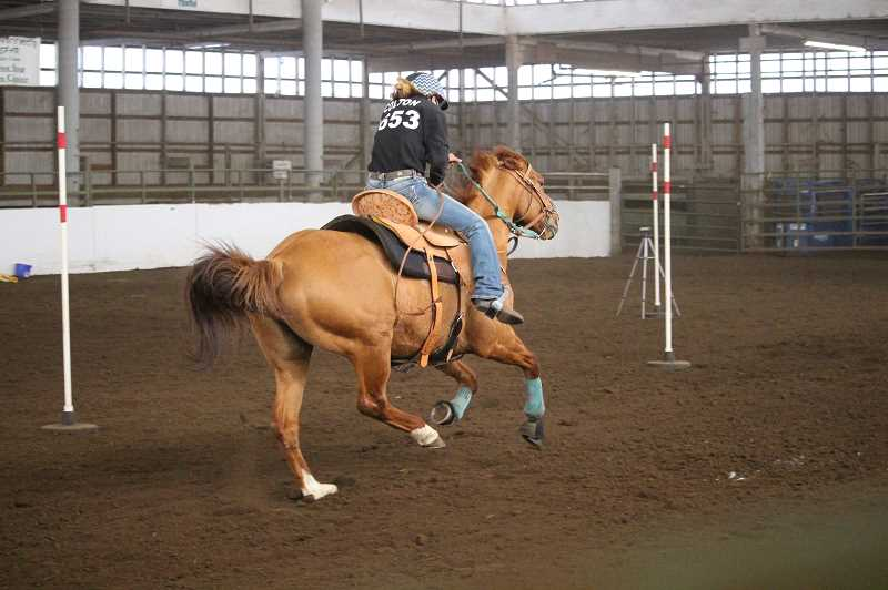 COURTESY PHOTO - Harmony Wassom, of Colton, competes in pole bending at the meet April 15-18.