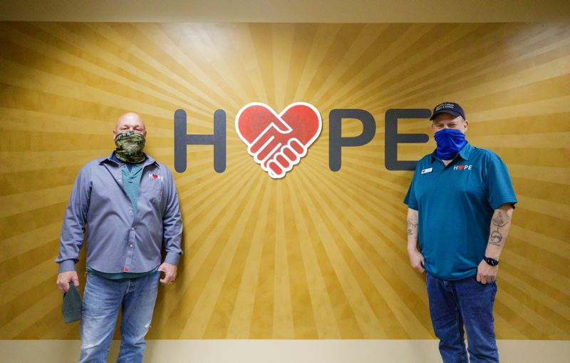 PMG PHOTO: JONATHAN HOUSE - Founder Alan Evans (left) and Facilities Manager Jeff Woodward in front of the new 'Hope' sign at the Bybee Lakes Hope Center.