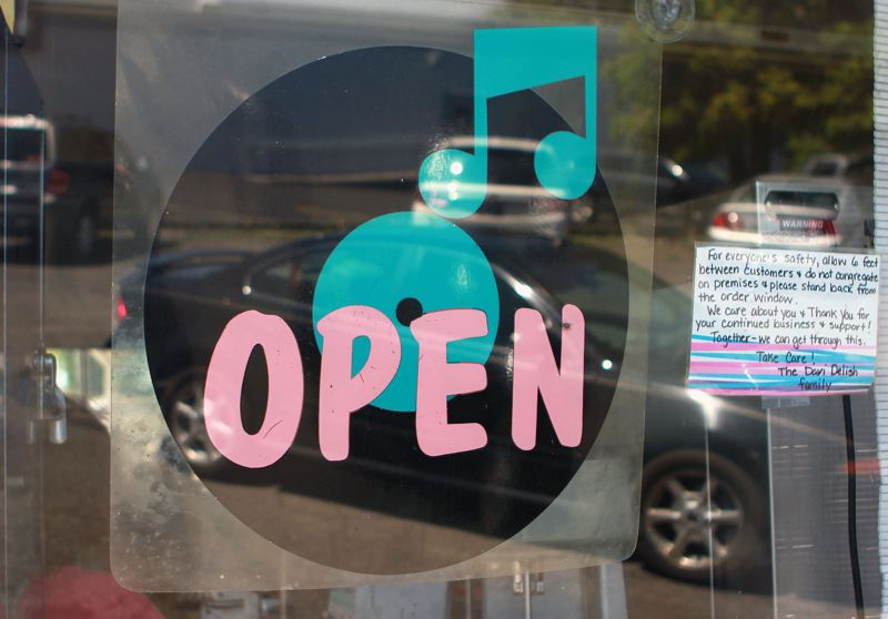 PMG PHOTO: MILES VANCE - A sign at Dari Delish in St. Helens invites in customers last summer.