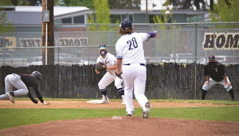 COURTESY PHOTO: SARAH OLIVER - The Canby High baseball team in action against Tualatin Monday afternoon.