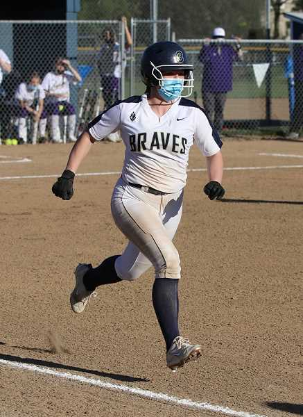 COURTESY PHOTO: STEWART MONROE - Banks senior Sydney Maller runs to first base after a hit during one of the Braves' six wins this season. Maller is batting .600 through six games this year.