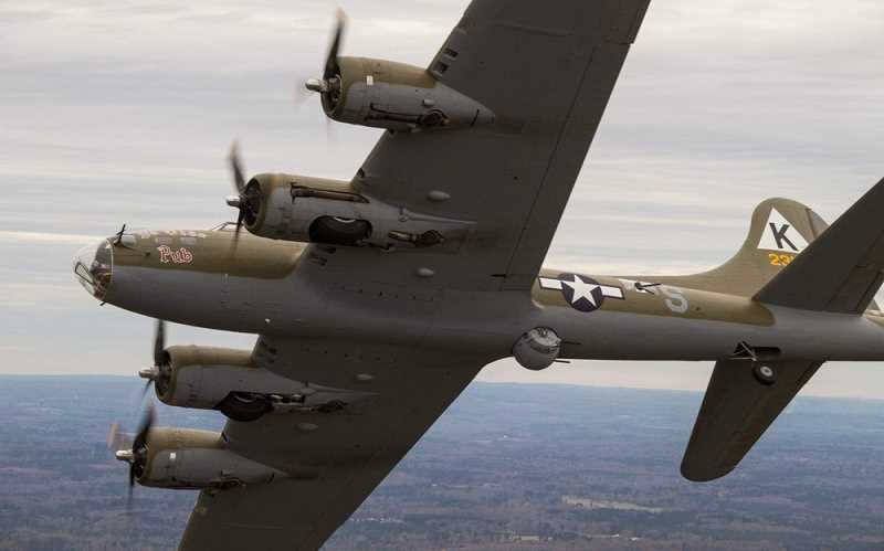 PHOTO COURTESY OF THE AIRSHOW OF THE CASCADES  - The Ye Olde Pub B-17 bomber in flight. Two B-17 Flying Fortress Bombers will fly at the Airshow of the Cascades in Madras in August. Ye Olde Pub is part of the Erickson Aircraft Collection.