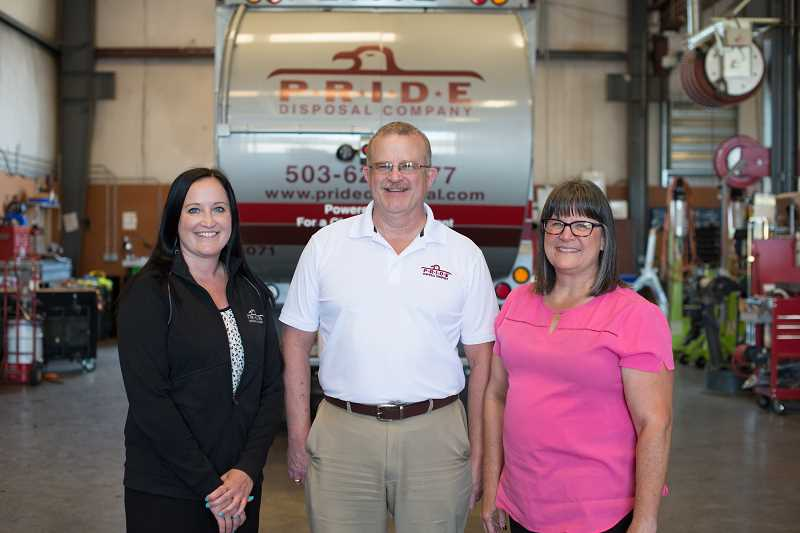 COURTESY PHOTO: TIGARD CHAMBER OF COMMERCE - Pride Disposal, a family-owned business based in Sherwood, won this years 2021 Tigard Chamber Business of the Year Award. From left to right are Kristin Leichner, Mike Leichner and Cindy Leichner.