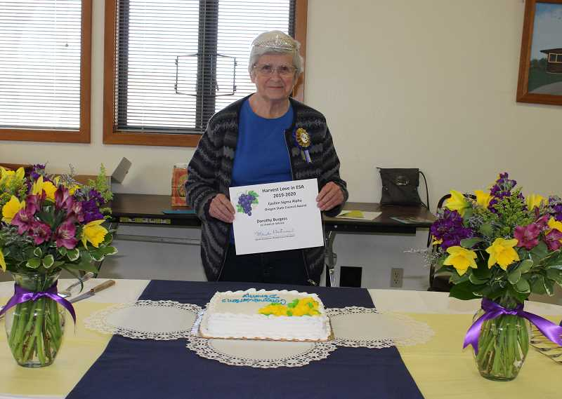 HOLLY SCHOLZ/MADRAS PIONEER   - Dorothy Burgess joined the Epsilon Sigma Alpha service organization in April of 1956 and was a charter member of the local chapter in 1962. Burgess received a certificate from the Epsilon Sigma Alpha Oregon State Council during a celebration last week.