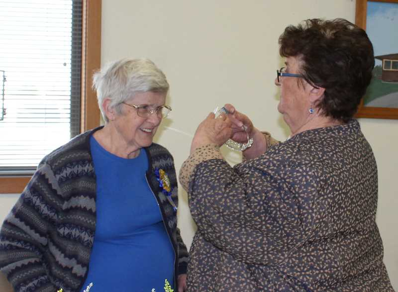 HOLLY SCHOLZ/MADRAS PIONEER   - Alpha Omicron Sorority President Jeri Fine places a crown on Dorothy Burgess.
