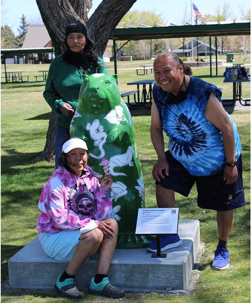 """PAT KRUIS/MADRAS PIONEER   - """"The Beaver Builds an Ecosystem"""" by artist Andries Fourie was installed at Sahalee Park in Madras last week as part of the High Desert Museum """"Dam It! Beavers and Us"""" exhibit. Pictured, Joie Johnson, sitting, Greg Youngman, right, and Brenda Cloud stop for a photo with the green and white beaver."""