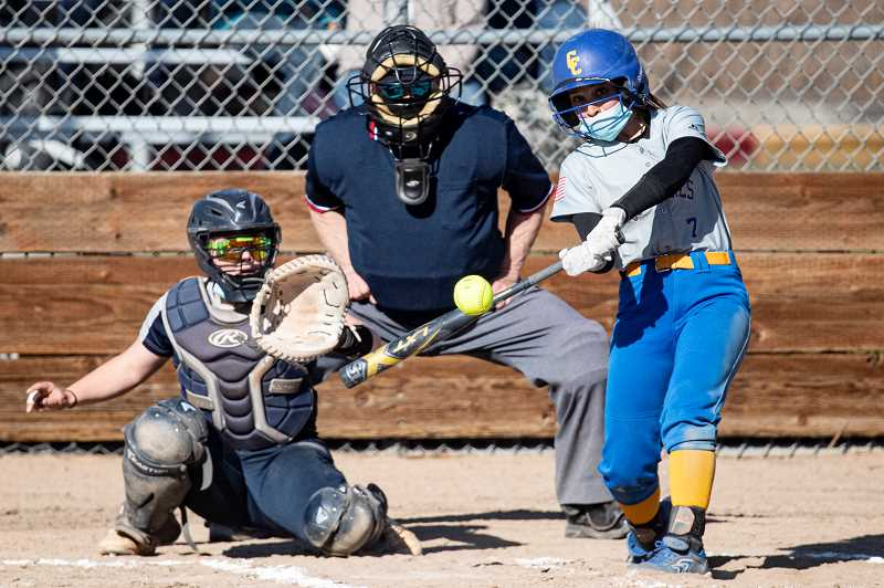 LON AUSTIN - Danner Hemphil squares up a home run swing during the Cowgirls' 15-12 win over Hood River in Prineville. Hemphil was one of many Cowgirls who had great weeks at the plate. Crook County hosts Redmond in a doubleheader Friday.