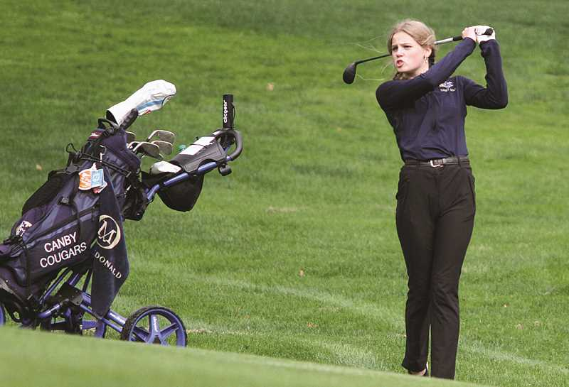 FILE PHOTO - The Canby girl's golf team won a league tournament outing by one stroke on their home course at Willamette Valley Country Club. The win put them six points clear of the field in the team title race.