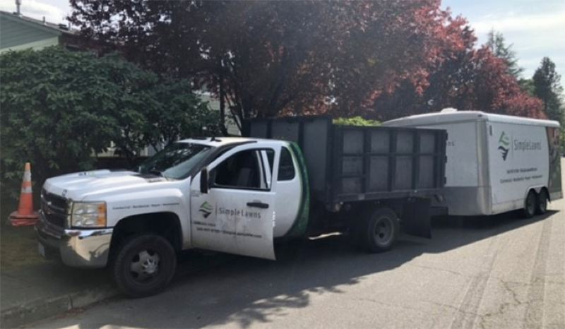 COURTESY PHOTO: PORTLAND POLICE BUREAU - The stolen landscaping truck and trailer.