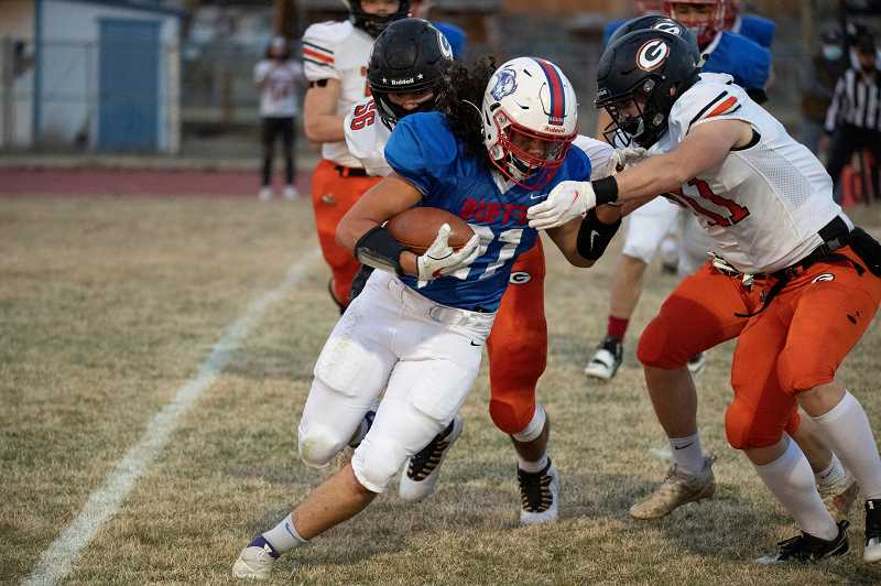 LON AUSTIN  - Jeremiah Smith, shown running the ball against Gladsone, did most of his work on the defensive side of the ball, earning the Tri-Valley's defensive player of the year honor