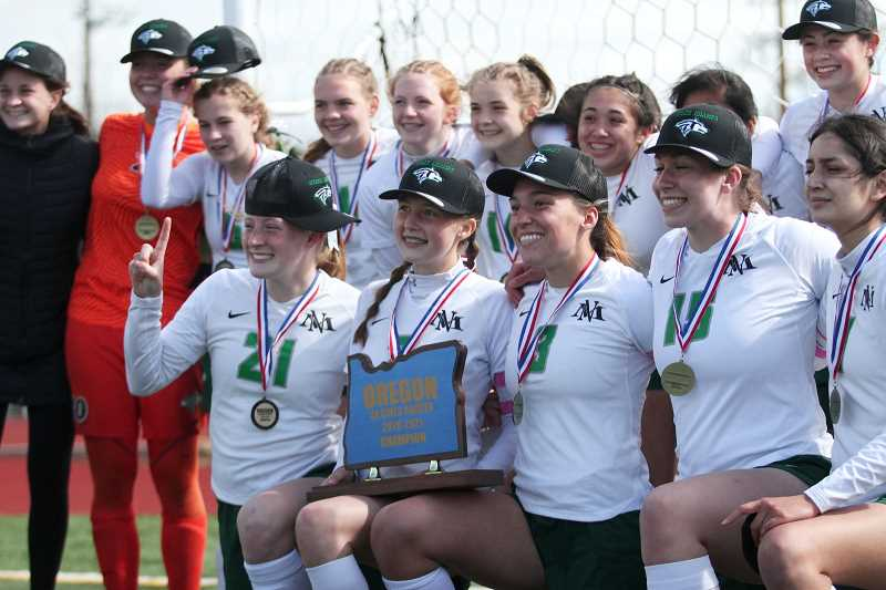PMG PHOTO: PHIL HAWKINS - After the North Marion girls soccer team won the 4A Showcase championship game, the Huskies sent a championship hot and photo to Marshfield athletic director Greg Mulkey, who helped organize the unofficial 4A state playoff.