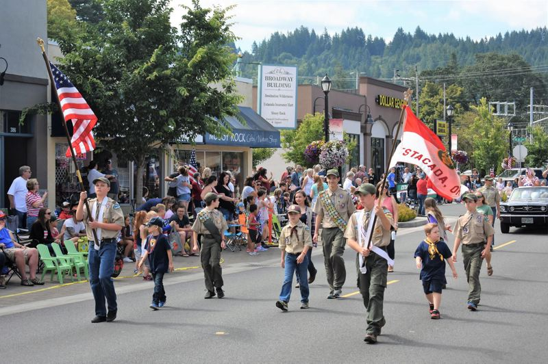 PMG FILE PHOTO - Estacada Boy Scouts march in the 2019 Fourth of July Parade. Photo taken pre-pandemic.