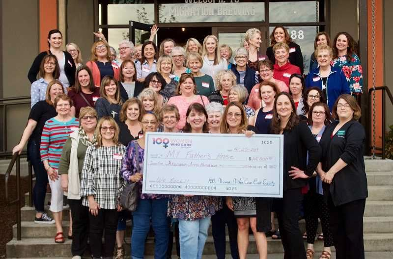 PMG FILE PHOTO - 100+ Women Who Care East County — pictured pre-pandemic — have been supporting nonprofit organizations for years.