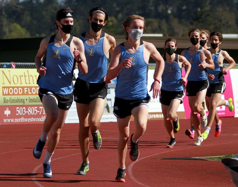 PMG PHOTO: MILES VANCE - The Lakeridge boys track team - like all others across the state - has been required to wear masks during competition in 2021.