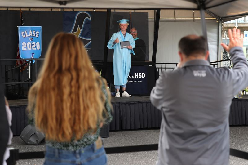 PMG FILE PHOTO - Jaxson Lake poses for a picture for his family during Liberty High School's graduation at Hillsboro Stadium in 2020.