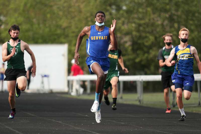 PMG PHOTO: PHIL HAWKINS - Gervais senior Brian Limage recovered from slipping out of the blocks to start the 100-meter dash to win the event with a personal record time of 11.22 seconds. Limage went on to break the school record in the 200 with a time of 22.64.