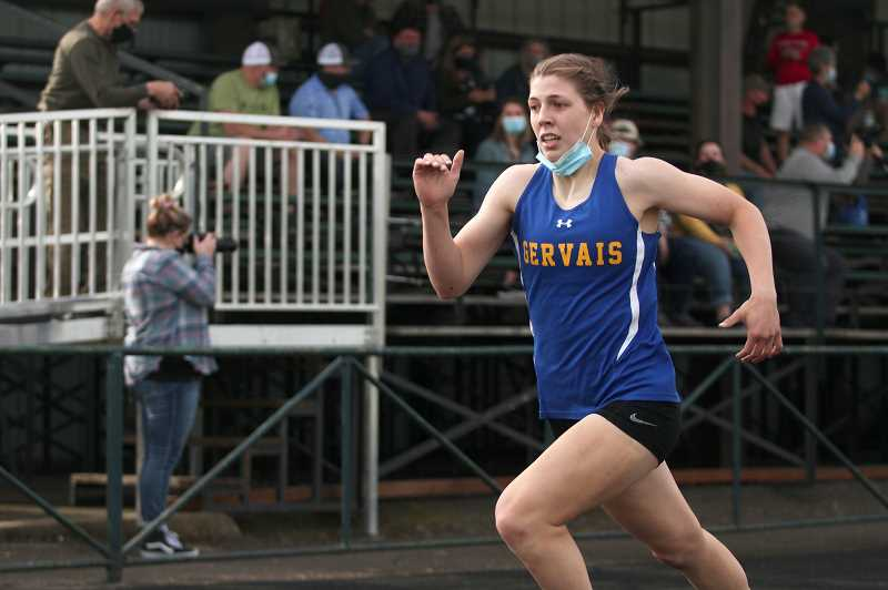 PMG PHOTO: PHIL HAWKINS - Gervais senior Katie Hanson holds the top times in the state at the 2A level in both the 200-meter dash (27.42) and the 400 (59.78). Hanson also has the third-best 2A time in the 100 (13.13) and the second-best mark in the long jump (15-09).