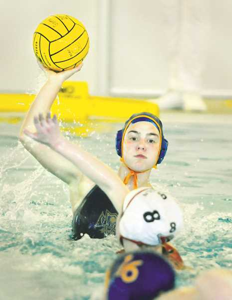 PMG PHOTO: GARY ALLEN - The NHS girls water polo team remains undefeated after a lopsided victory over Lincoln April 29 at the Chehalem Aquatic Center.